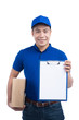 Smiling young asian salesman with parcel and clipboard against a white background