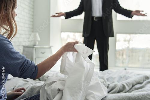 Woman holding white male shirt Canvas Print