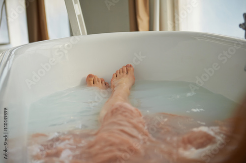 Fototapety, obrazy: Legs resting in the tub of a person. Cleopatra bath with milk. Beauty relaxation