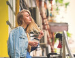 Young long blond hair woman having coffee to go. Street fashion style concept.
