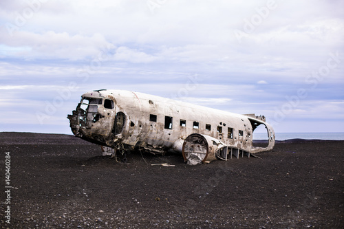 Airplane wreckage on black sand beach. Iceland Wallpaper Mural