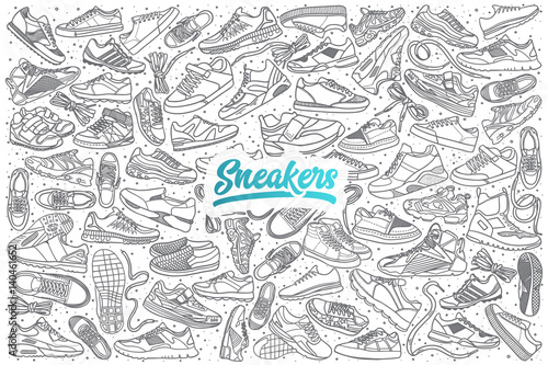 Fotografia  Hand drawn sneakers doodle set background with blue lettering in vector