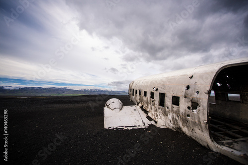 Photo  Airplane wreckage on black sand beach. Iceland