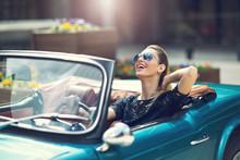 Portrait Of Beautiful Sexy Fashion Woman Model In Sunglasses Sitting In Luxury Retro Cabriolet Car
