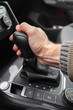 Driver hand holds automatic gear lever