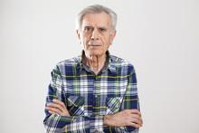 Portrait Elderly Man On Gray Background
