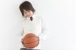 School Boy in Uniform Holding Basket Ball
