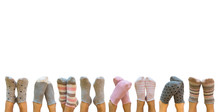 Female Legs In Colorful Socks Isolated On White Background