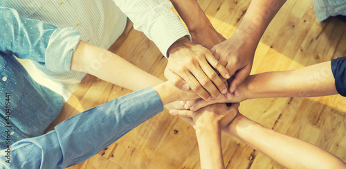 Fotomural Teamwork concept,Business team standing hands together in the loft office