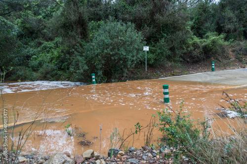 Photo  Översvämmad väg efter skyfall