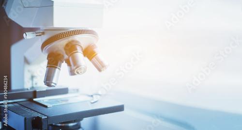 Carta da parati  medical laboratory, scientist hands using microscope for chemistry test samples,examining samples and liquid,Medical equipment