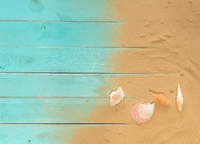 Sea Sand And Sea Shells On Blue Wooden Floor,Top View With Copy Space