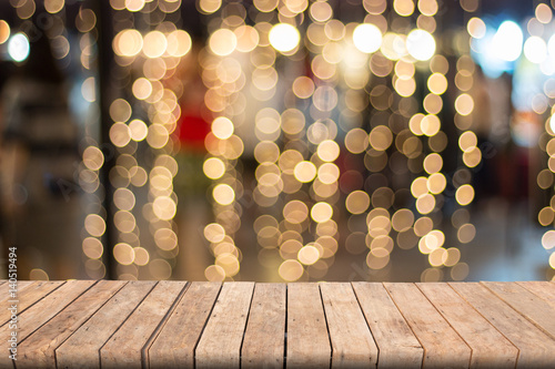 Fotografie, Obraz  Warm bokeh blurred background on wooden table