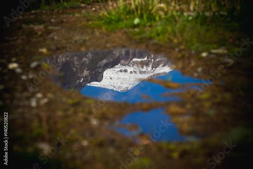 Poster Reflexion caraiman mountain peak in romania reflected in a lake