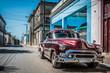 HDR - Roter amerikanischer Oldtimer parkt auf der Straße im Vorort von Havanna Kuba - Serie Kuba Reportage