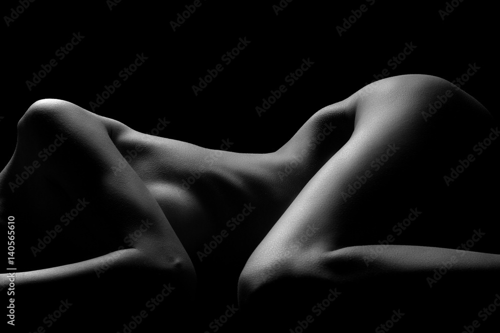 Fototapeta Sexy body nude woman. Naked sensual beautiful girl. Artistic black and white photo.