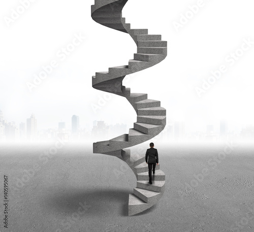 Businessman climbing concrete spiral staircase Canvas-taulu