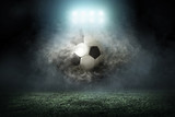 Fototapeta sport - Soccer player with ball in action outdoors