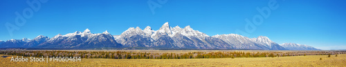 Foto auf Leinwand Gebirge Panoramic picture of the Grand Teton Mountain Range in autumn, Wyoming, USA