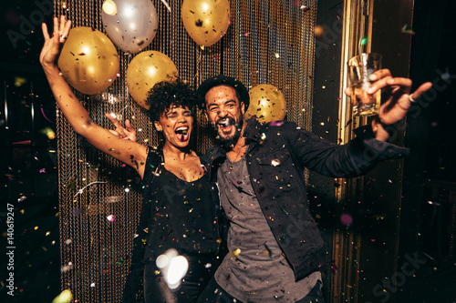 Energetic couple dancing in the night club
