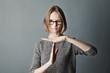 Leinwandbild Motiv Closeup portrait woman showing time out gesture with hands