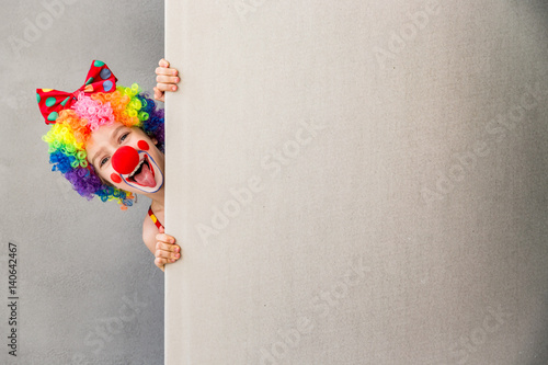 Tableau sur Toile Funny kid clown playing indoor