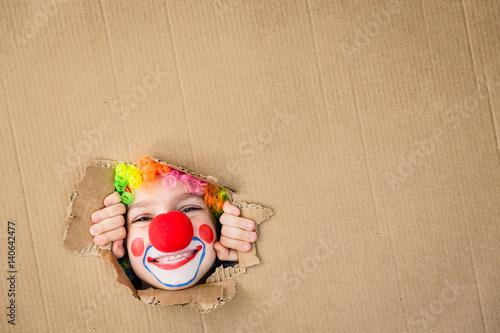 Foto op Aluminium Carnaval Funny kid clown playing indoor