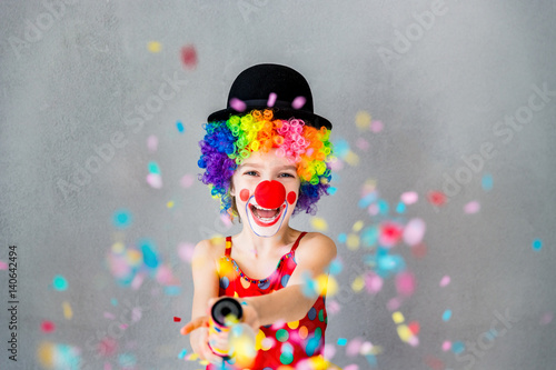 Funny kid clown playing indoor Fototapete