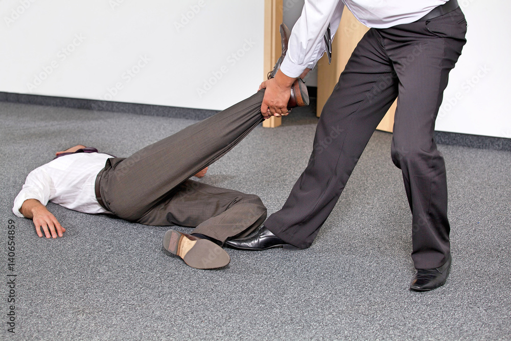 Fototapety, obrazy: Businessmen pulling colleague's leg at office