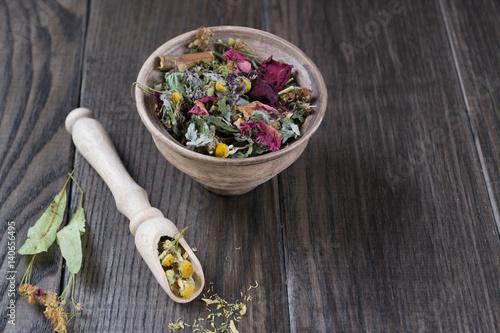 Papiers peints Pansies Herbal tea ingredients with hip roses, chamomile, herbs on wooden table