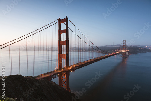 High angle view of Golden gate Bridge over sea against clear sky at dusk Poster