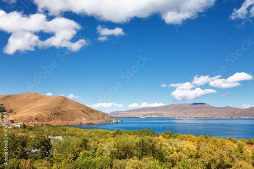 Fényképezés  Sevan lake and white clouds blue sky on a sunny day, Armenia