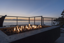 Gas Lit Backyard Fire Pit On The Beach House Outdoor Patio At Sunset