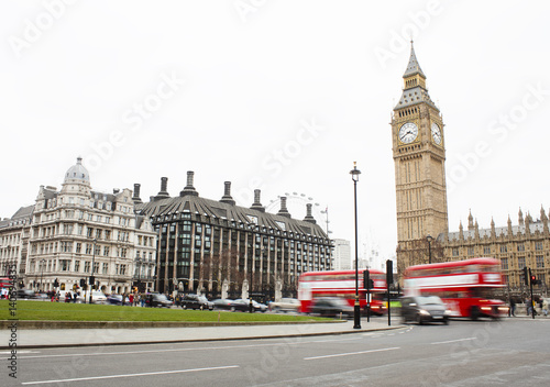 Poster London Traffic in Central London city, long exposure photo of red bus in intersection, Big Ben in background