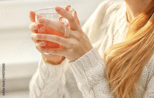 Recess Fitting Tea Woman holding cup of tea with raspberry jam, closeup