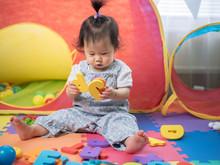 Baby Girl Learning Alphabet Bl...
