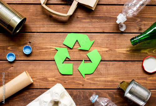 Valokuva  Eco concept with recycling symbol on table background top view
