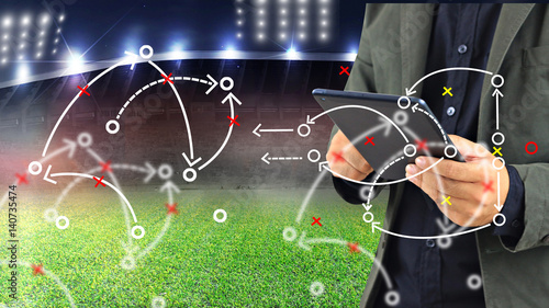 Fotografía  Football manager planning tactic with soccer field and bright spotlights