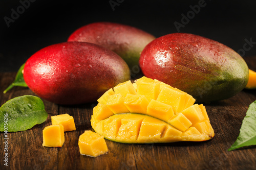 Some mango on wooded board.