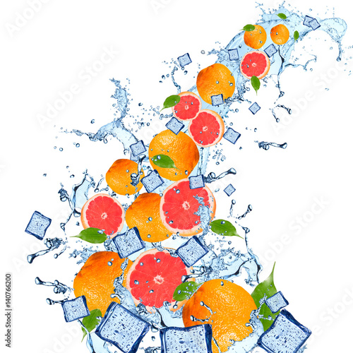 Water splash with grapefruits isolated on white background. Splash motion with fruits. Abstract object