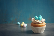 Decorated Easter Cupcake On Blue Background