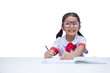 Asian little girl doing homework with smile isolated on white background with clipping path