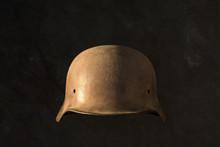 A Rusty German World War Two Military Helmet, On Black Background