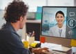Man having a video call with his colleagues on desktop pc