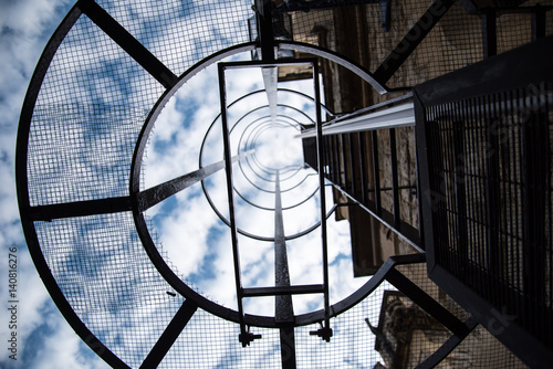 Fototapety, obrazy: Staircase on a building to the clouds and sky