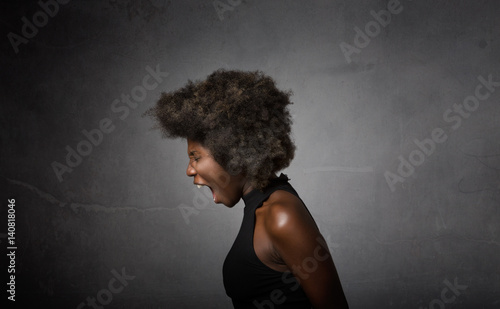 Valokuva  african girl screaming in lateral view