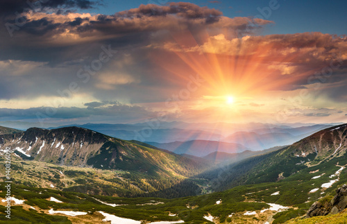Fotobehang Landschap Beautiful landscape in the mountains at sunset. View of colorful sky with clouds.