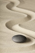 zen meditation stone and sand, sheng fui Buddhism in a spiritual japanese rock garden. Abstract harmony and balance concept for purity concentration spa relaxation..