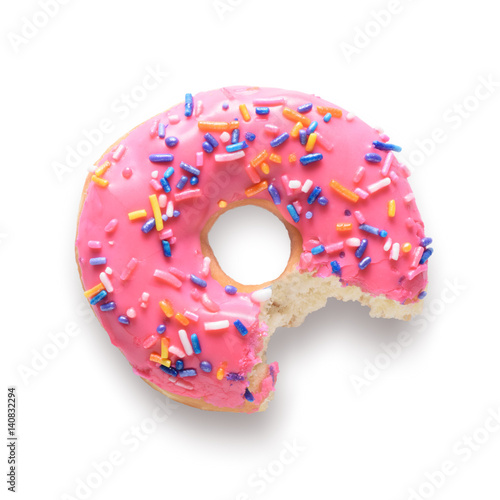 Photo  Pink frosted donut with colorful sprinkles with bite missing