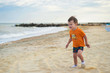 baby on the beach near the sea in summer